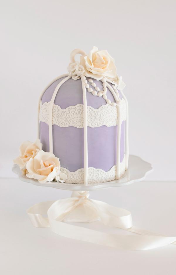 Lavender birdcage themed wedding cake with ivory sugar roses