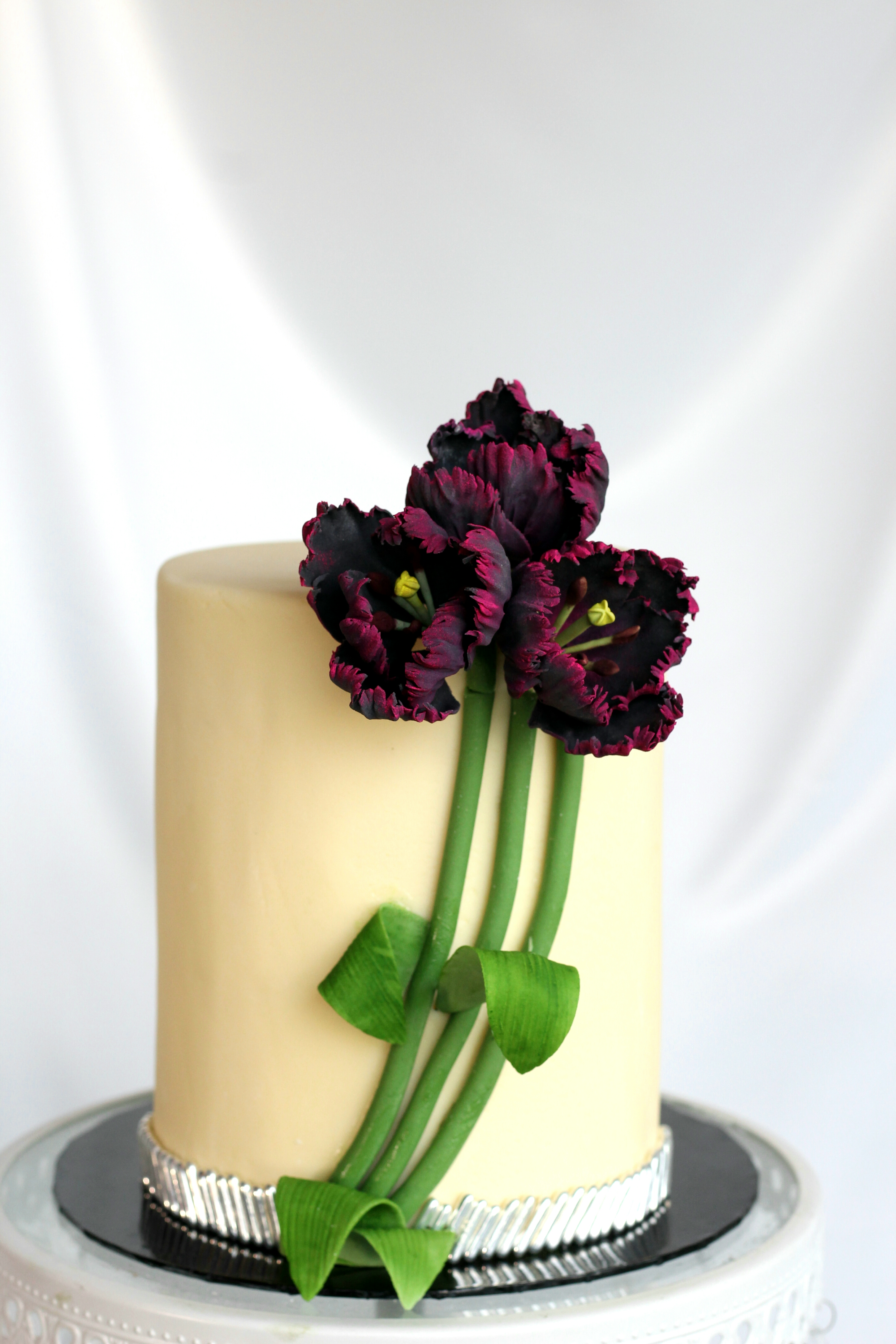 Mini white wedding cake with dark raspberry sugar flowers