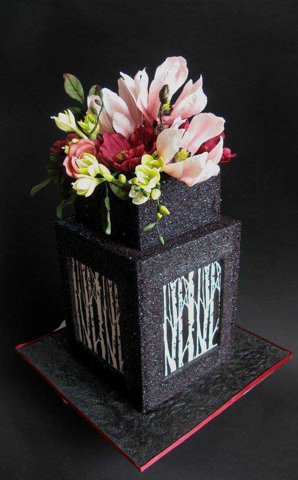 Black glitter square cake with sugar flowers