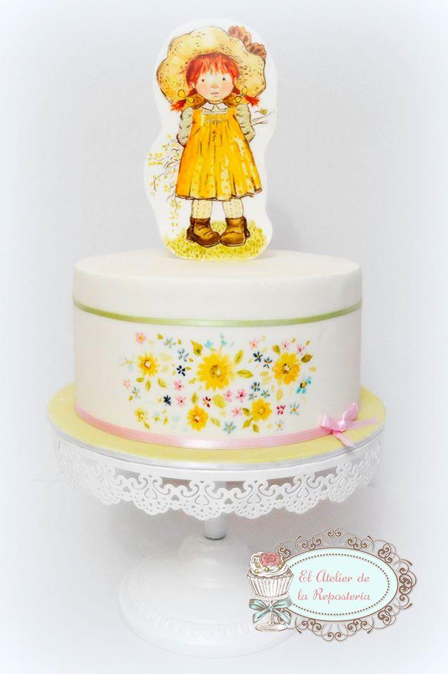 Flowered Little girl cake with hand painted cookie on top