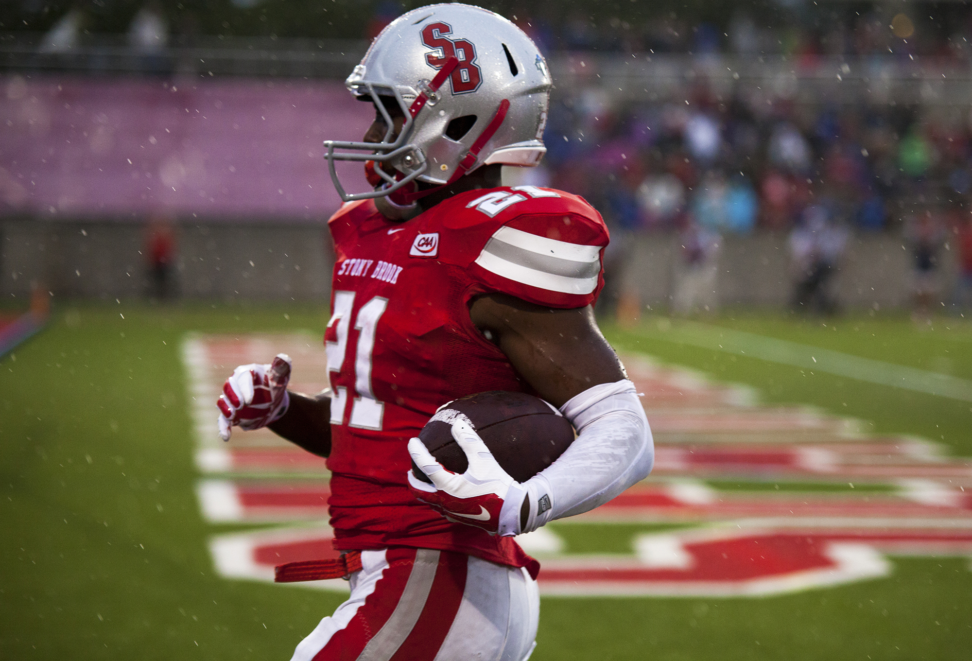 Stony Brook junior running back Stacey Bedell (No. 21, above) in the immediate aftermath of scoring a touchdown against the Central Connecticut Blue Devils in Stony Brook's first football game of the 2015 season. Bedell would end up out of play for the rest of the year due to a shoulder injury. CHRISTOPHER CAMERON/THE STATESMAN
