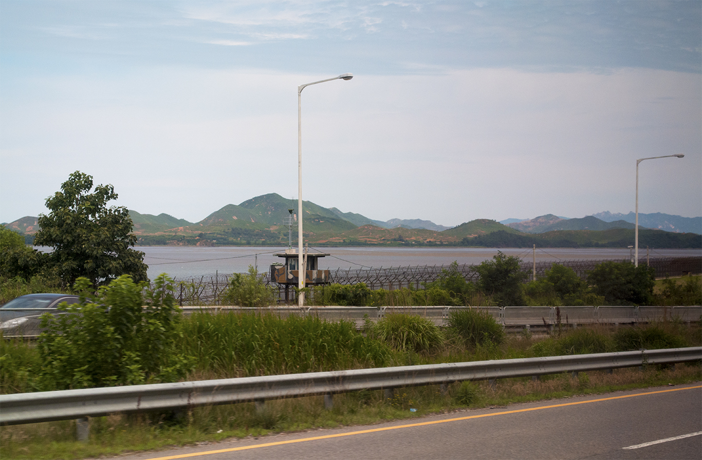 A section of the Imjin river where the Military Demarcation Line bisects the river. South Korean checkpoints at the barbed wire fence are equipped with searchlights. (CHRISTOPHER CAMERON/THE STATESMAN)