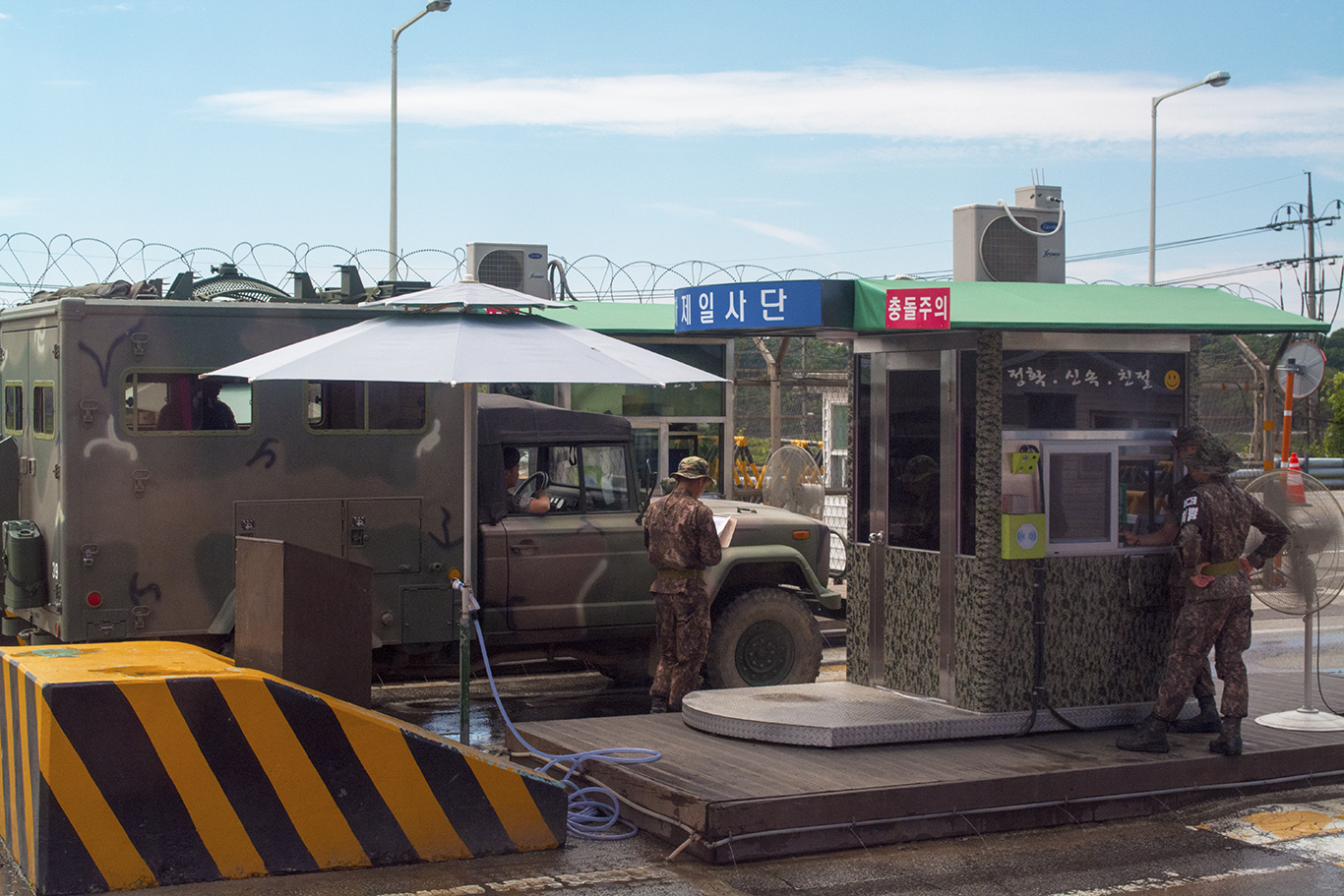 A South Korean military checkpoint at the entrance to the Korean Demilitarized Zone. Every vehicle that passes through the checkpoint is searched, and passport identification is required to gain entry,(CHRISTOPHER CAMERON/THE STATESMAN)