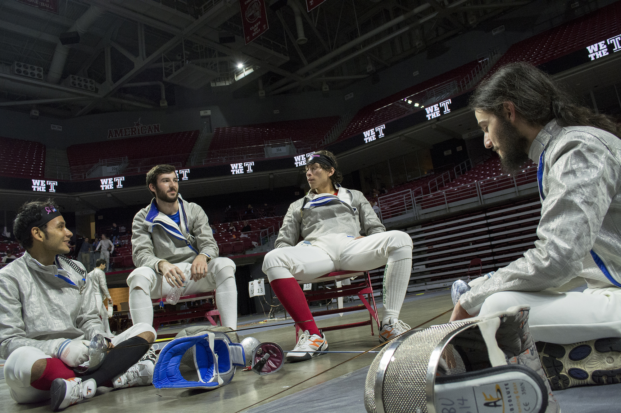 From left, sabre fencers sophomore  Andres Carajaval, senior Alex Muller, sophomore Braulio Trejo, and freshman Alex Babiak rest before the beginning of the direct elimination round of the Men's Sabre division. All four would be eliminated in the Table of 64. CHRISTOPHER CAMERON/THE STATESMAN