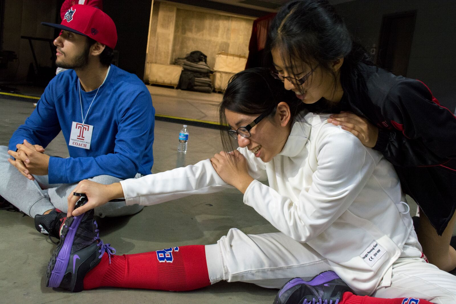 Stony Brook sophomore épée fencer Olivia Hu (above, right) helps sophomore épée fencer Brianna Bawayan stretch out for her direct elimination match against Haverford épée fencer Julie Petersen. Bawayan would go on to place 47th out of 84 in her division. CHRISTOPHER CAMERON/THE STATESMAN