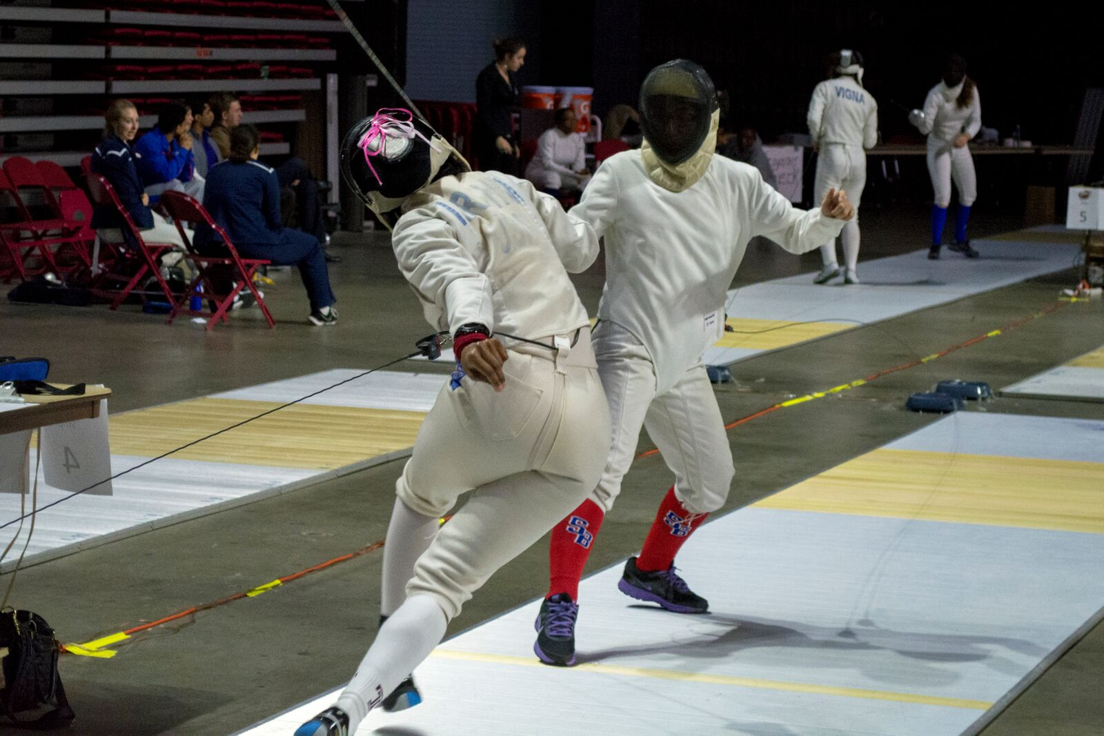 Stony Brook sophomore épée fencer Brianna Bawayan (above, right) defends herself in a bout against Temple University's Safaa Ibrahim at the 2015 Temple Collegiate Open. Ibrahim would go on to place 2nd in the Women's Épée division. CHRISTOPHER CAMERON/THE STATESMAN