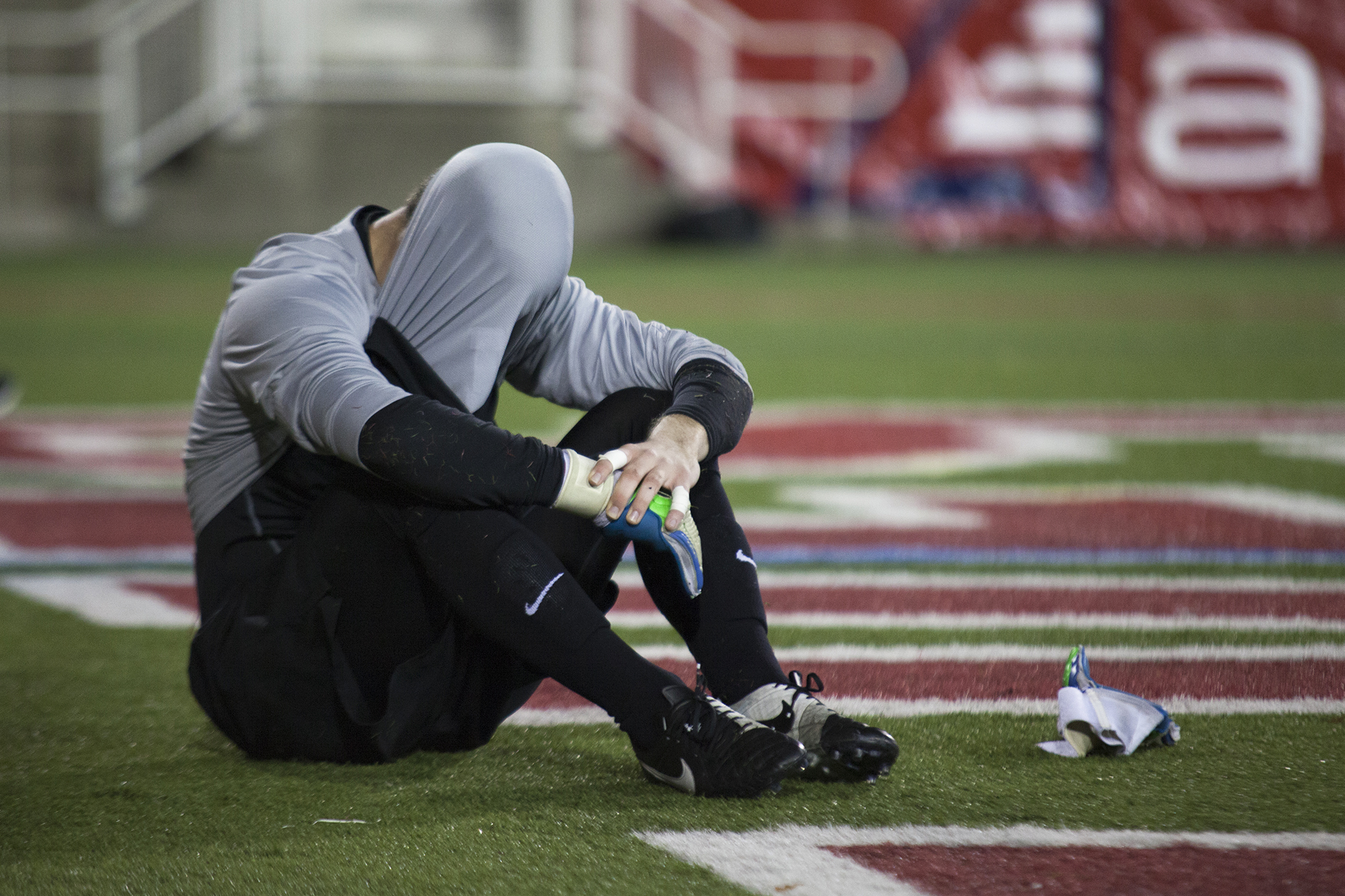 Stony Brook goalkeeper Jason Orban sits with his face covered after the men's soccer team's 3-2 loss against Binghamton on Nov. 7, 2015. The match went into double overtime as Binghamton managed to meet Stony Brook's 2-0 lead before scoring a goal in the 16th minute of overtime. CHRISTOPHER CAMERON/THE STATESMAN