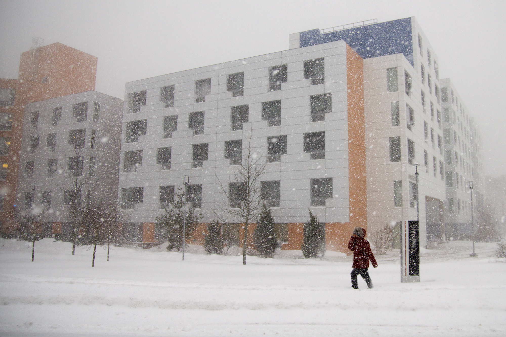 A person treks through the snow in front of Yang College. ERIC SCHMID/THE STATESMAN