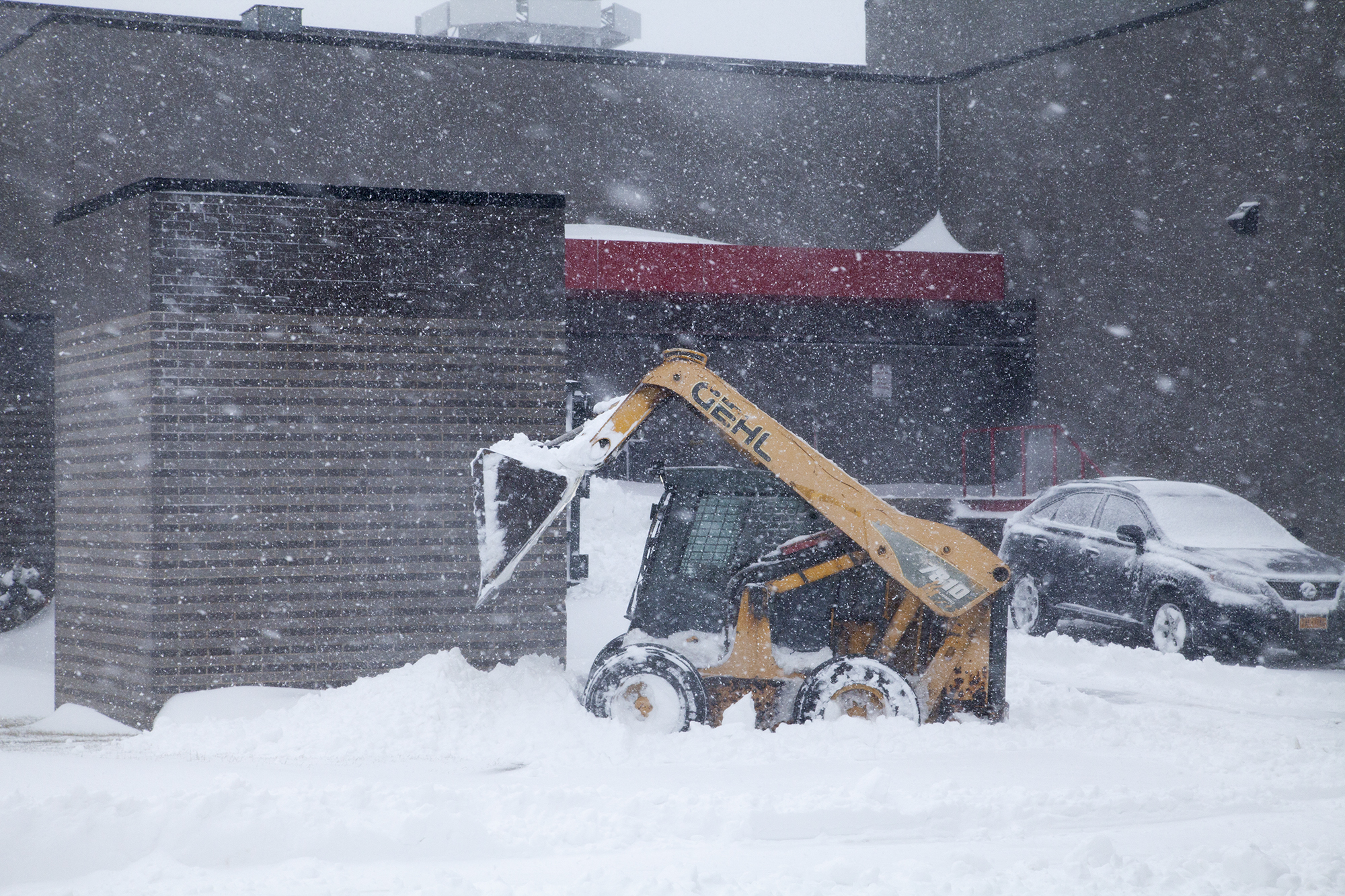 A snow plow at Stony Brook University during Winter Storm Jonas on Saturday, Jan. 23. Snow plows operated both day and night on Saturday to clear roads and walkways. CHRISTOPHER CAMERON/THE STATESMAN