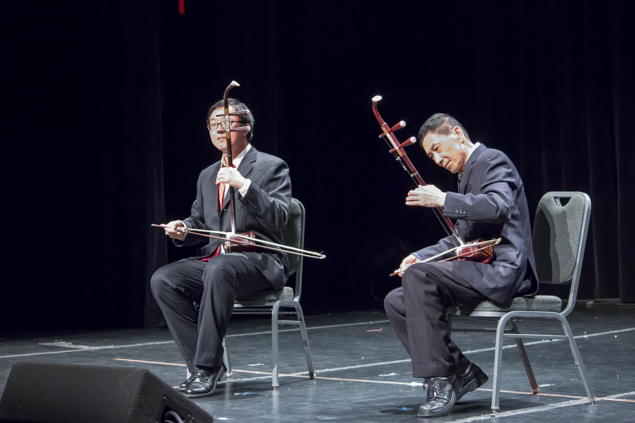 "Yingrou Zhao (left) and Zongchun Zhao performed a piece titled ""Battle Horse Galloping"" on the Erhu, a two-stringed, bowed musical instrument. The Erhu originates back to a group of instruments introduced to China more than a thousand years ago.  MANJU SHIVACHARAN/ THE STATESMAN"