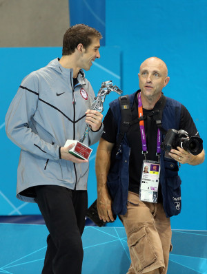 Al Bello, above right, talks to Olympic swimmer Michael Phelps during the 2012 Olympics in London. STATESMAN STOCK PHOTO