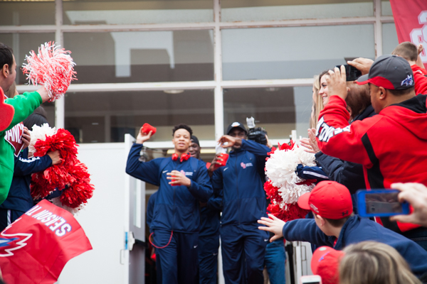 The Stony Brook Men's Basketball team throws shirts at the cheering fans who were waiting for them. KRYSTEN MASSA/THE STATESMAN