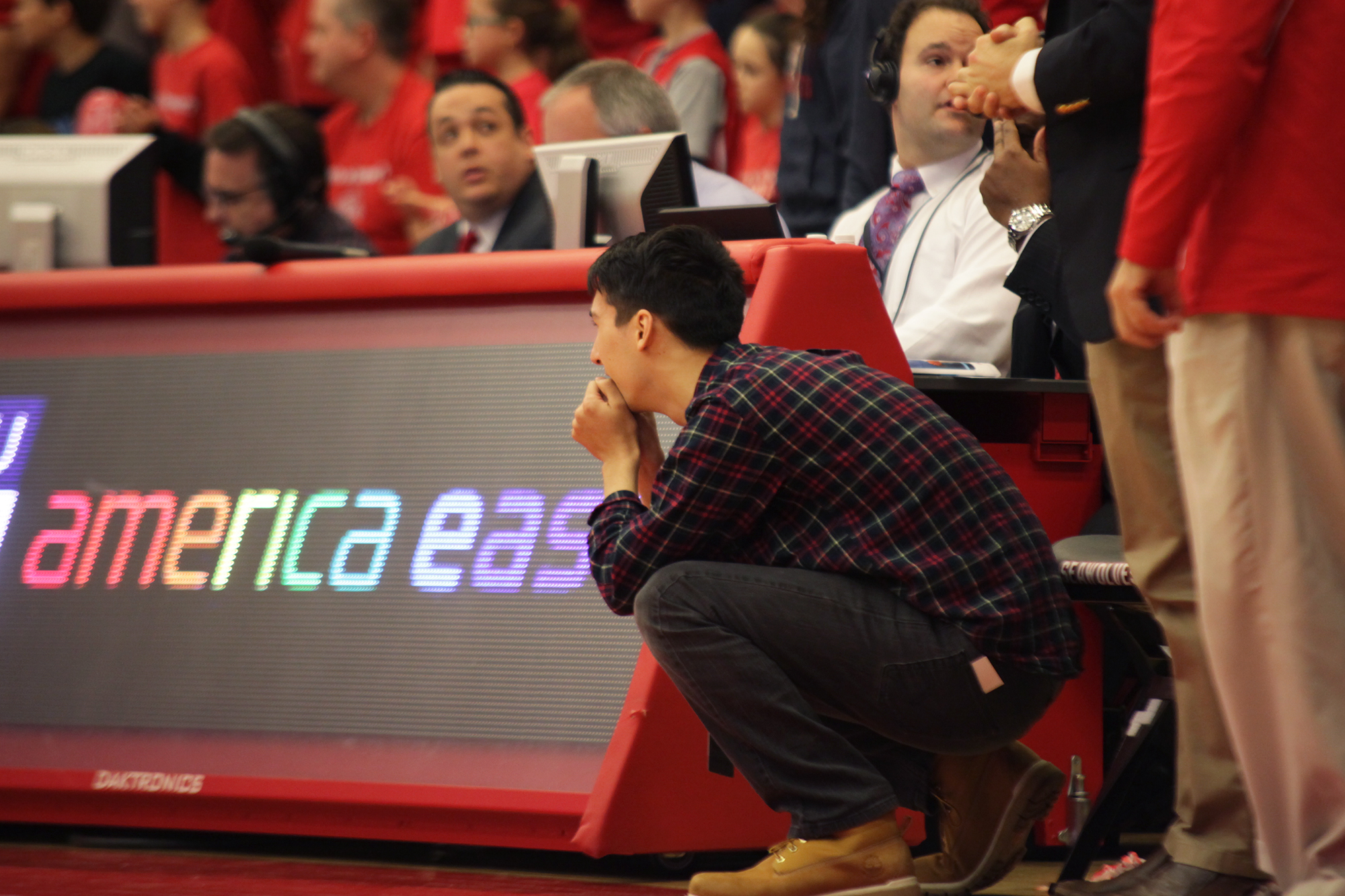 Samuel Stanley III, the son of Stony Brook University President Samuel L. Stanley Jr., watches on as the Seawolves maintain a one-point lead over Vermont during the championship game with less than three minutes of game time. CHRISTOPHER CAMERON/THE STATESMAN
