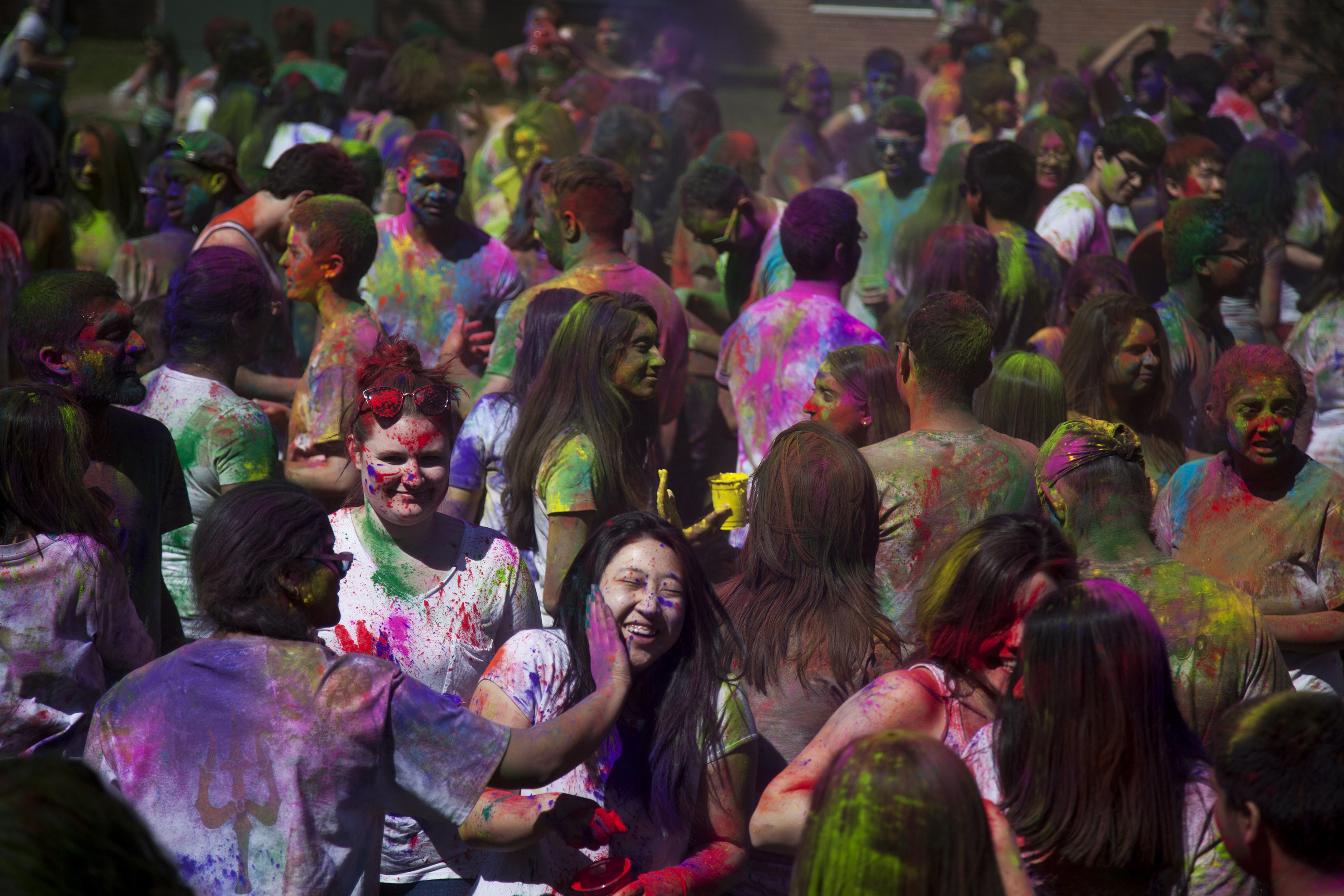 Students, above, celebrated Holi in the Mendelsohn pit on Sunday. They wore white shirts threw colorful powder on each other. ERIC SCHMID/THE STATESMAN