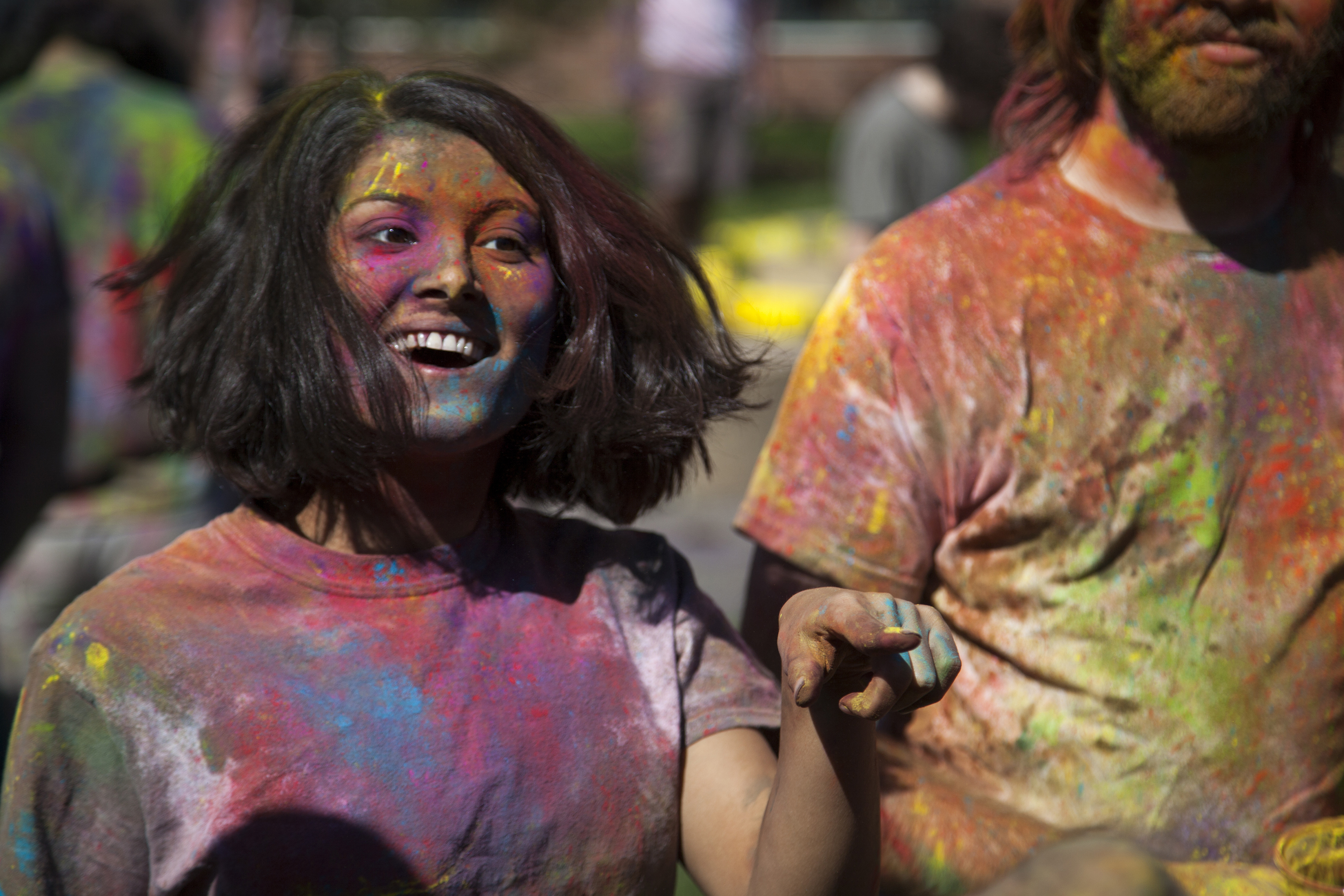 Kiran Sharma, above, dances to traditional Indian music during the Holi celebrations on Sunday. ERIC SCHMID/THE STATESMAN