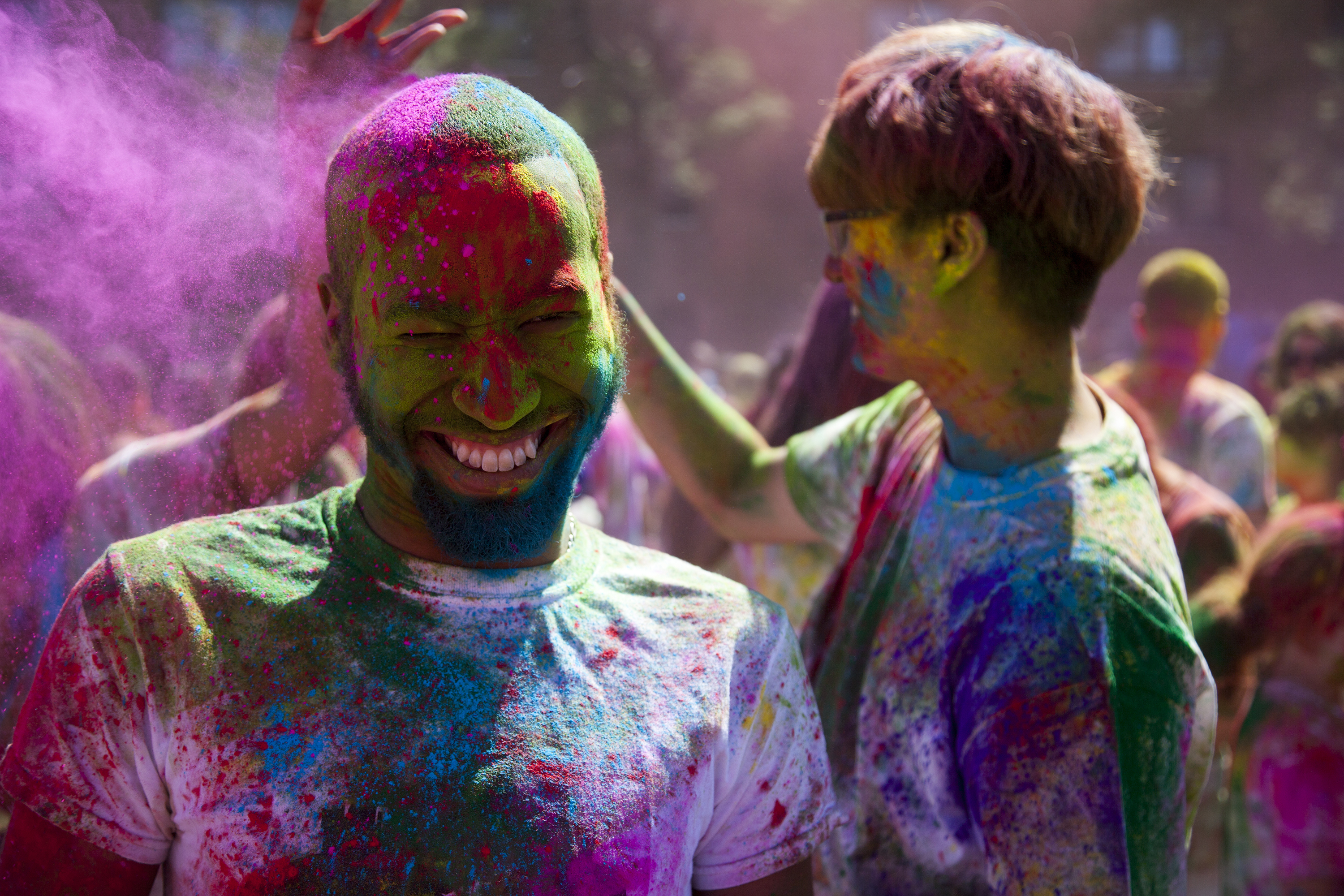 Patrick Bernabela, above, braces as purple powder is thrown on him during Holi. ERIC SCHMID/THE STATESMAN