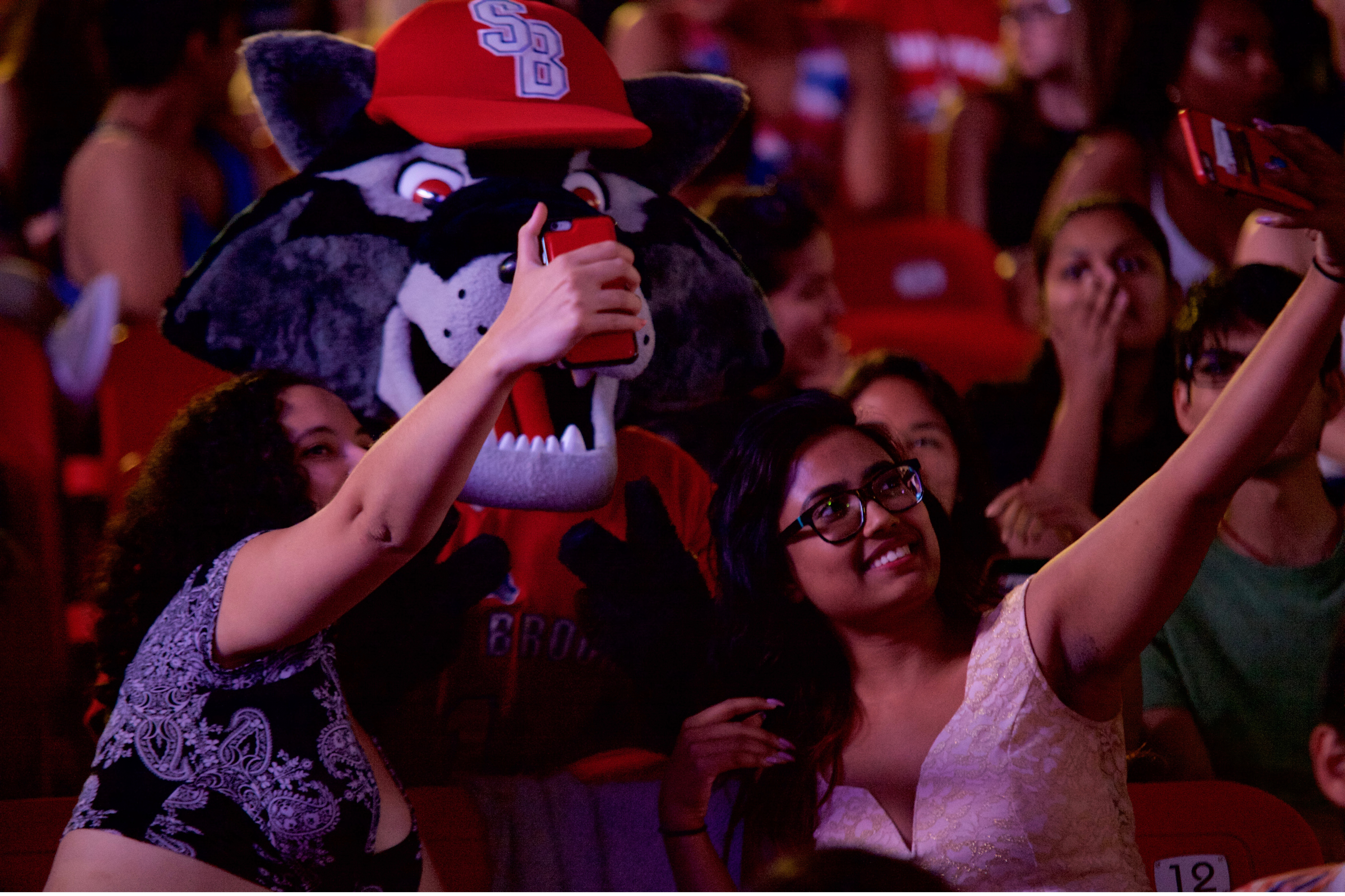 Lauren Kruger, left, and Prova Akter, right, take a selfie with Wolfie during the break between The Commas and RL Grime. ARACELY JIMENEZ/THE STATESMAN