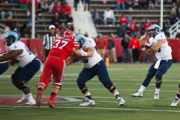 Junior linebacker John Haggart (No. 37 above) block against the Rhode Island offense on Oct. 15. Haggart forced 3 fumbles against Delaware propelling Stony Brook to a 28-3 victory. ARCELY JIMENEZ/THE STATESMAN