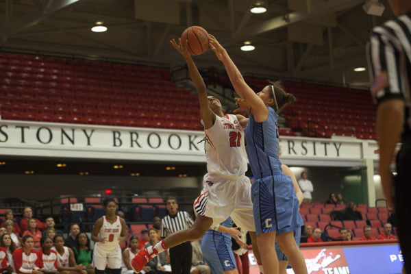 Junior guard Aaliyah Worley (No. 21, above) attempts to score in a game against Columbia on Nov. 22 at Island Federal Credit Union Arena. ARACELY JIMENEZ/THE STATESMAN