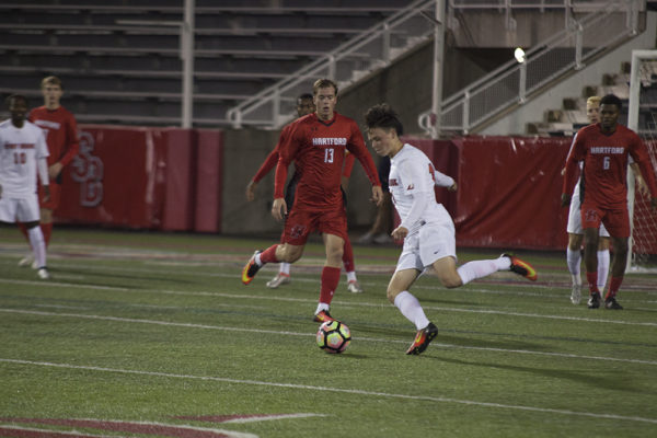 Freshman midfielder Macdara Heanue looks to make a play at the top of the 18-yard box. Heanue scored Stony Brook's only goal in their loss against Hartford on Wednesday Nov. 9. ARACELY JIMENEZ/THE STATESMAN