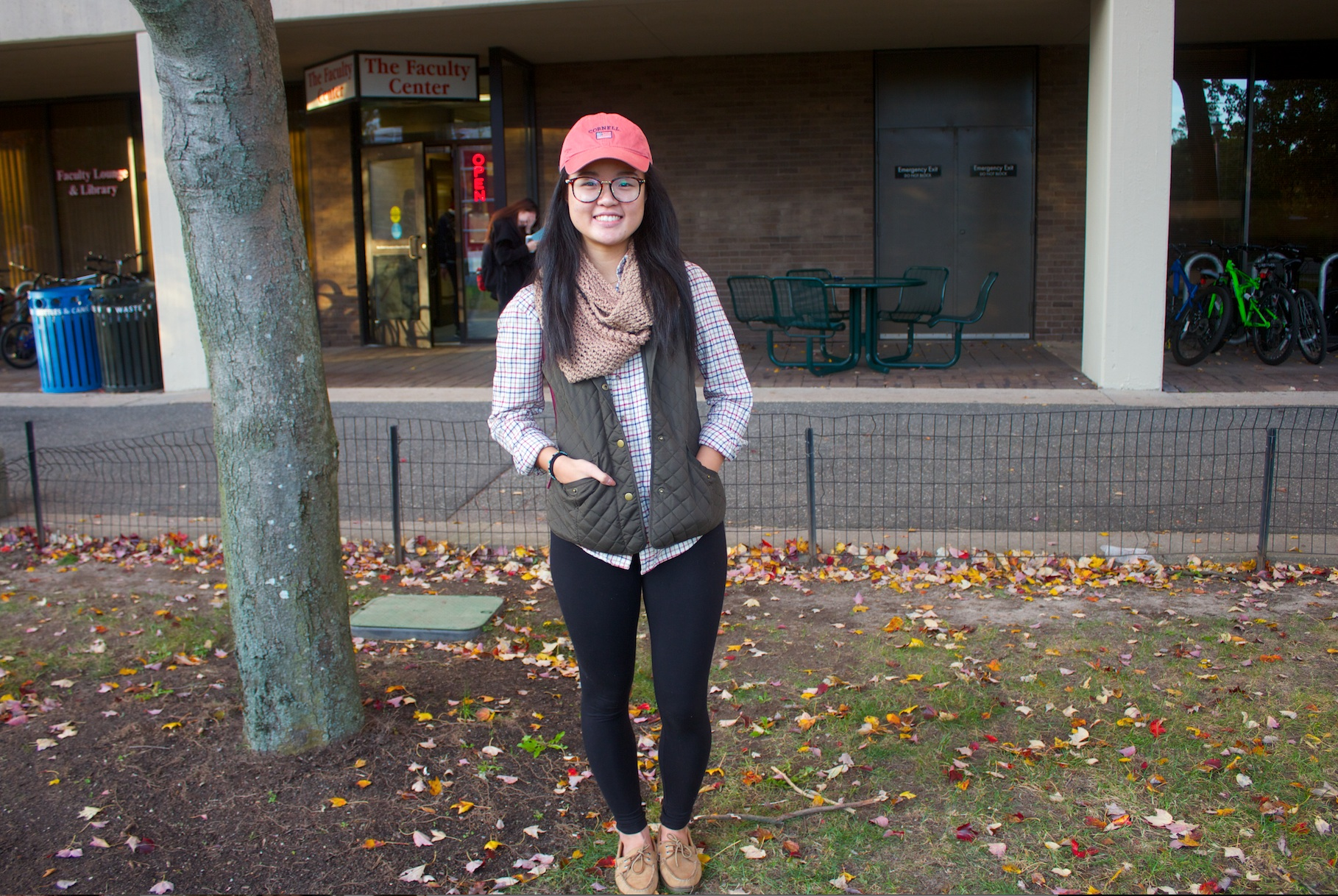 Wendy Liu, freshman health science major. Leggings are from Banana Republic, scarf is knitted, vest is from Bass and flannel is thrifted. RAWSON JAHAN/THE STATESMAN
