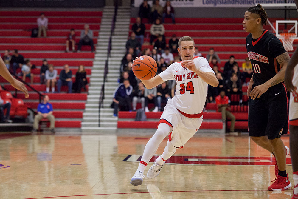 Senior guard Lucas Woodhouse drives to the basket against Northeastern Dec 3. Despite his career-high 19 points, Stony Brook was not able to defeat NJIT, falling 64-61. ERIC SCHMID/THE STATESMAN