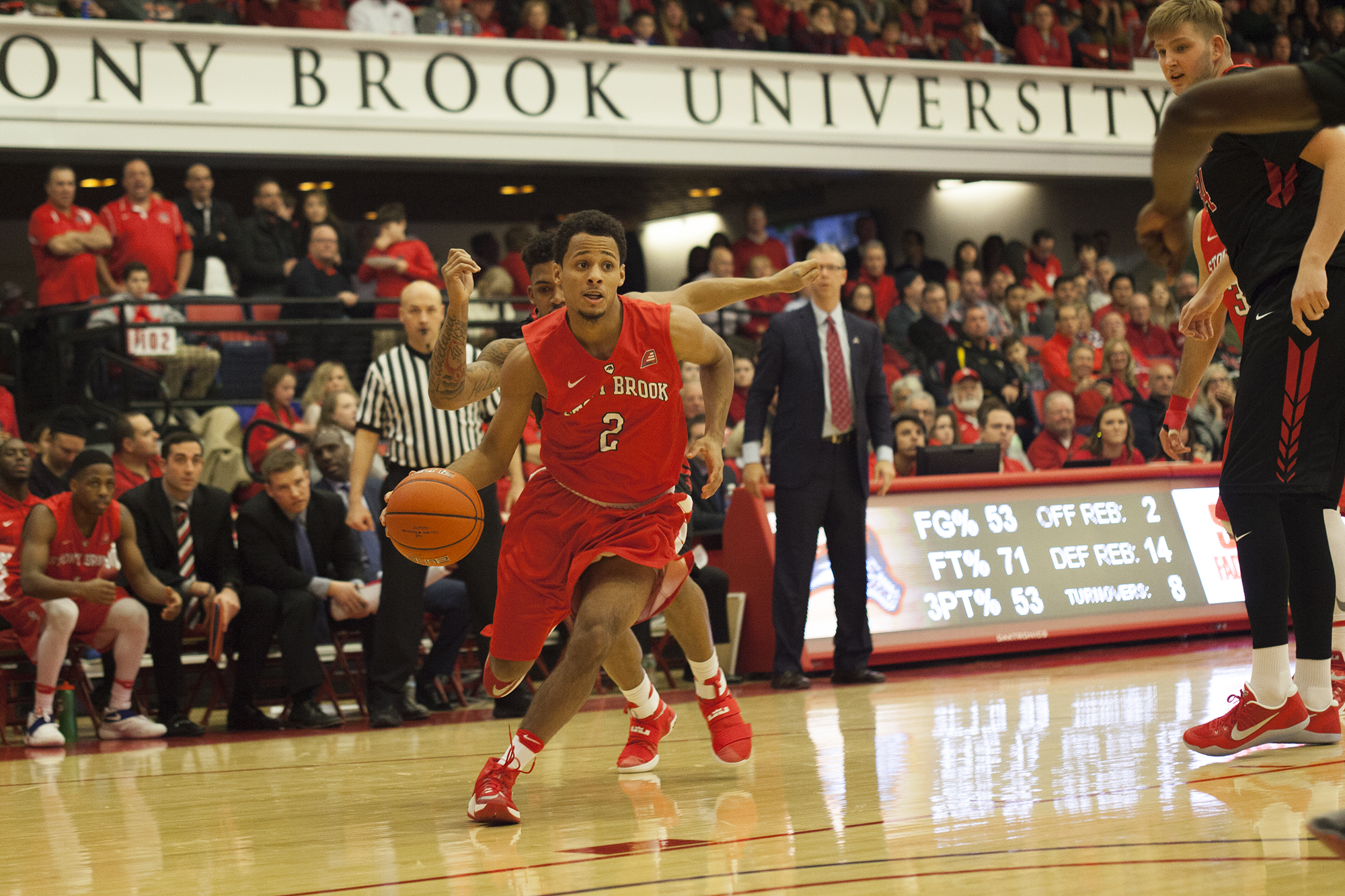 Freshman guard Michael Alomancy in a game against Rutgers on Dec. 10 at Island Federal Credit Union Arena. Although Stony Brook fell to Hofstra 999-000, Alomancy scored a career high of 15. ARACELY JIMENEZ/THE STATESMAN