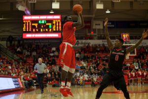 Redshirt freshman guard Akwasi Yeboah (No. 15, above) hits a three-point jump shot against Rutgers on Dec. 10. Despite having a career high, the Seawolves fell to the Scarlet Knights 71-66. ARACELY JIMENEZ