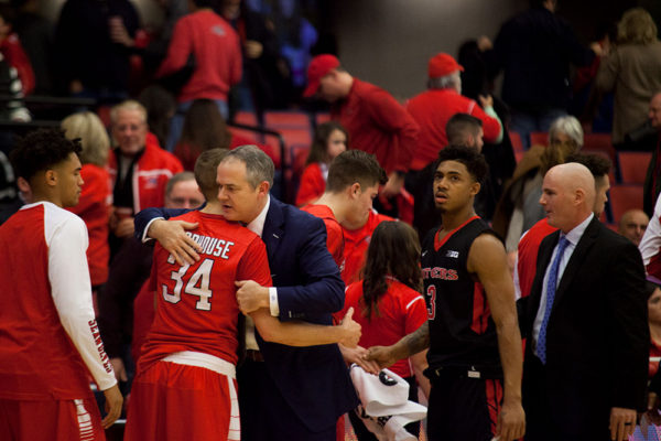 Senior guard Lucas Woodhouse (No. 34) embraces his former coach Steve Piekell after Stony Brook played Rutgers on Dec. 10. Piekell now coaches the Scarlet Nights. ARACELY JIMENEZ/THE STATESMAN