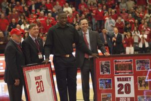 Jameel Warney, center, stands with St. Sen. Kenneth P. LaValle, Stony Brook President Samuel L. Stanley, and Director of Athletics Shawn Heilbron (left to right) during a halftime ceremony retiring Warney's number on Saturday night. LUIS RUIZ DOMINGUEZ