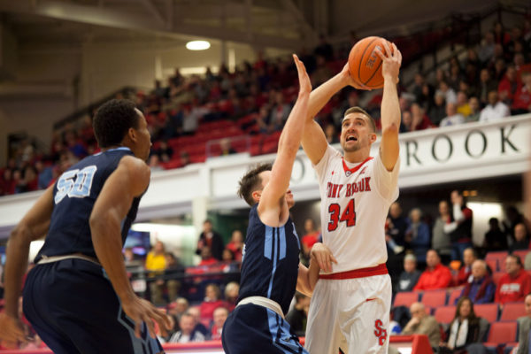 Senior guard Lucas Woodhouse (No. 34, above) looks to pass the ball against Maine on Feb. 12. He scored 15 points in Stony Brook's win over Hartford last night. LUIS RUIZ DOMINGUEZ/THE STATESMAN