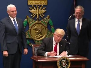 "President Donald Trump signs Executive Order 13796 on Jan. 27. The order, commonly referred to as an ""immigration ban"" bars people from seven countries to enter the United States. PHOTO CREDIT: PUBLIC DOMAIN"