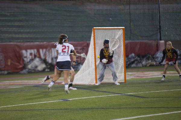 Freshman attacker Taryn Ohlmiler scores a goal in a game against USC on March 24. ARACELY JIMENEZ/THE STATESMAN