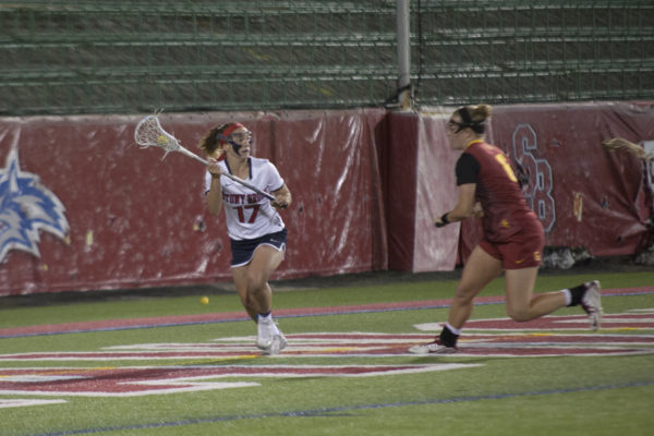 Junior attacker Kylie Ohlmiller looks to make a pass in a game against USC on March 24. ARACELY JIMENEZ/THE STATESMAN