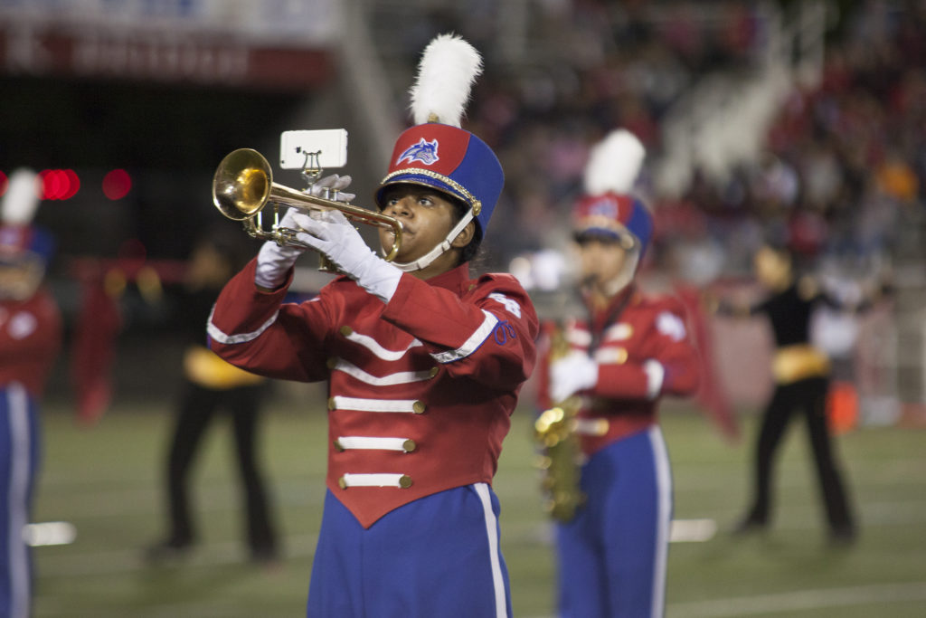 The marching band performed with band alumni during the halftime show. ARACELY JIMENEZ/THE STATESMAN