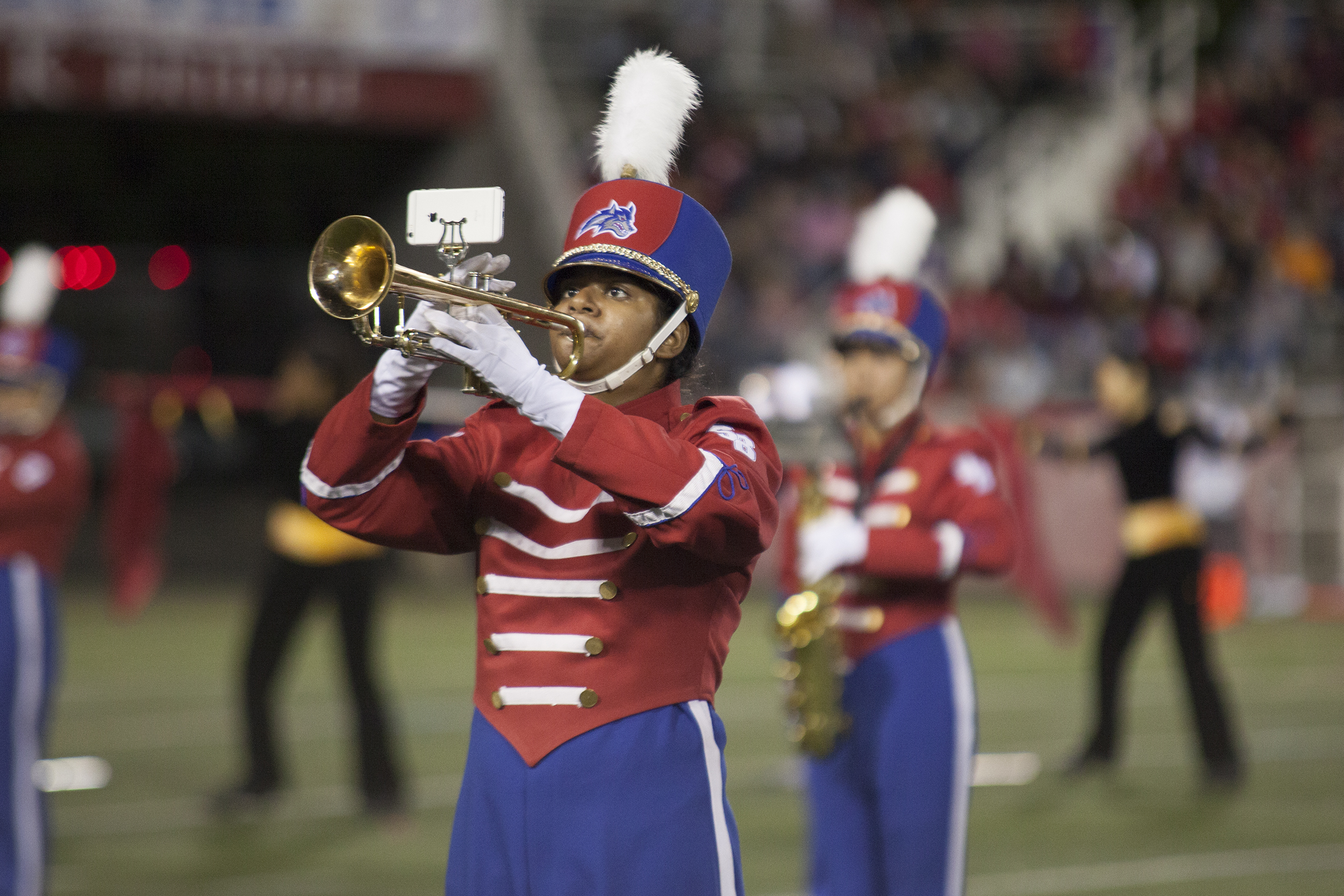 The marching band performed with band alumni during the halftime show. <em>ARACELY JIMENEZ/THE STATESMAN</em>