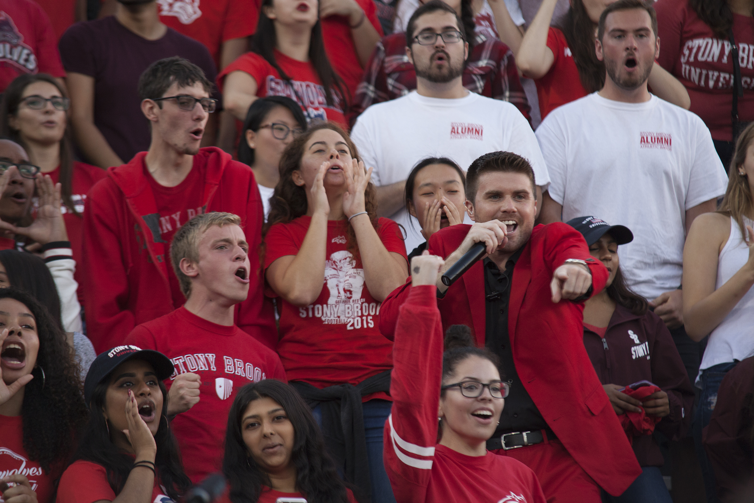 General Manager Chris Murray joins students and alumni in the stands to energize the crowd. <em>ARACELY JIMENEZ/THE STATESMAN</em>