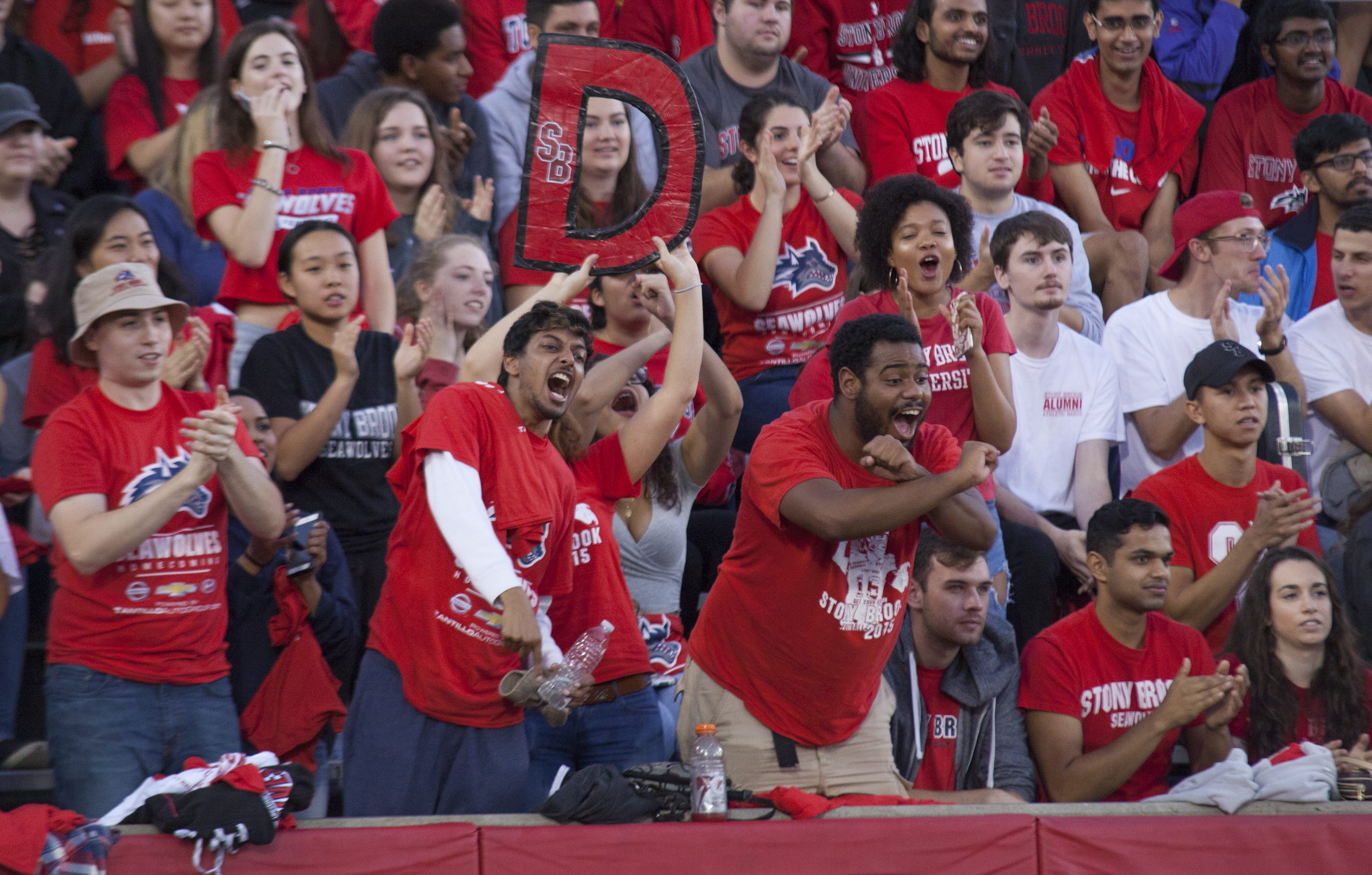 Fans cheer on the defense as the Seawolves keep the Wildcats from reaching the endzone. <em>ARACELY JIMENEZ/THE STATESMAN</em>