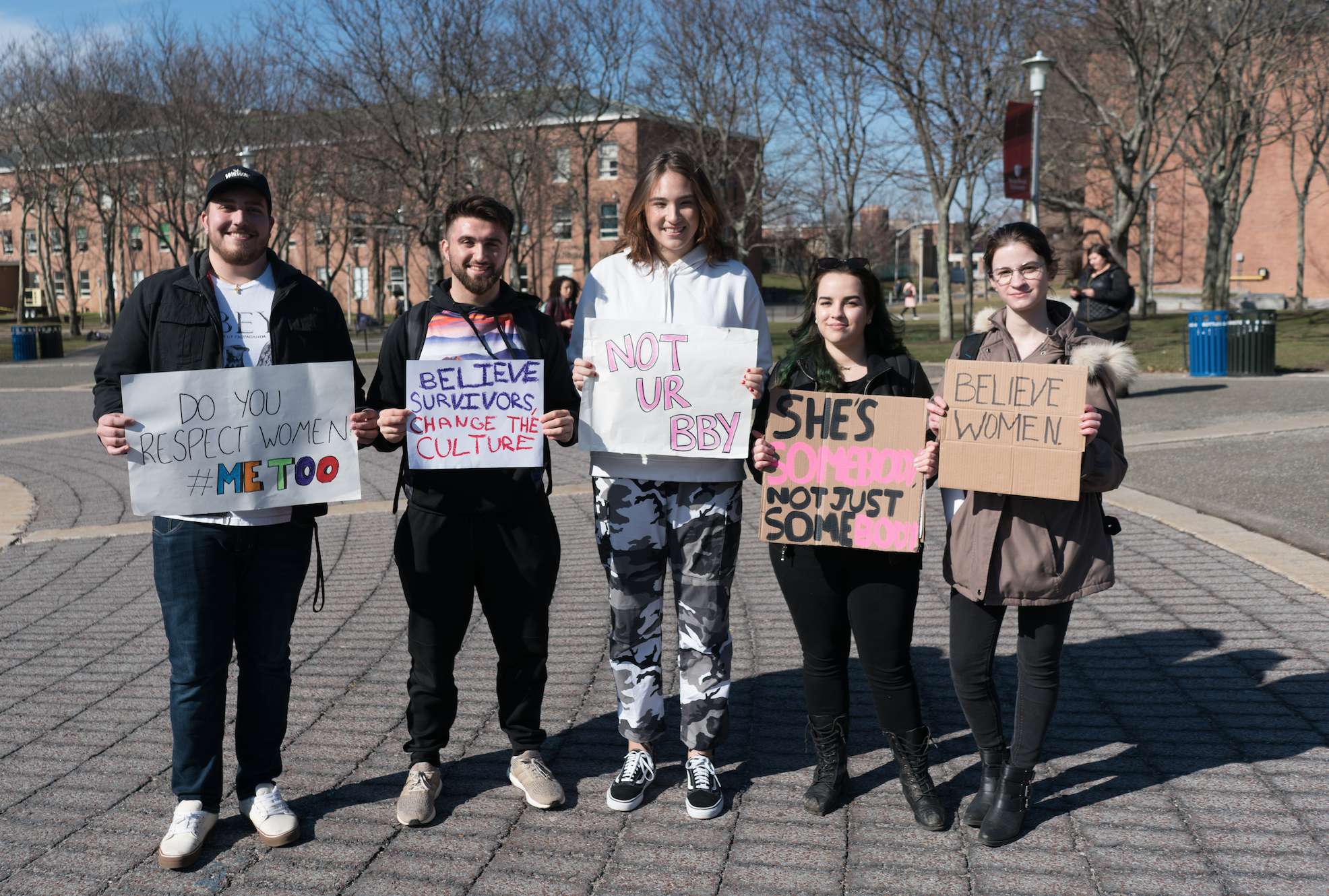 Students at the march made their own posters to show support of the movement. <em>GARY GHAYRAT/THE STATESMAN</em>
