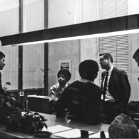 Michael Graves, Don Mizell, and Michael Smith speaking with Deans Robert Barr and Frederick Hargadon during the 1969 sit-in