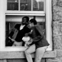 "Russell Frisby and Aundrea White Kelley at ""private"" entrance to Admissions Office during the 1969 sit-in"