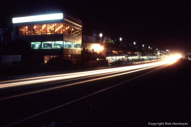 A time-exposure photograph illustrating streaks from headlights during the 24 Hours of Le Mans on June 20, 1982, at Circuit de la Sarthe in Le Mans, France.