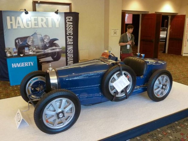 Lot # 025 1930 Bugatti Type 35B Grand Prix; S/N 4948; Engine # 200T; Dark Blue/Black leather; Estimate $750,000 - $900,000; Competition restoration, 3+ condition; Hammered Sold at $580,000 plus commission of 10.00%; Final Price $638,000 – RHD. Single sidemount spare, alloy wheels, driver's aeroscreen. Blower # 267, Steering Box #7. – Originally delivered to Guy Bouriat who drove it to third in the 1930 Monaco GP, then in Germany. Original frame rails sold (?) and now reproduced. Many original parts including upper and lower crankcase, blower drive, intake manifolds, steering box, gearbox and front axle. Recently given a thorough freshening by Jim Stranberg. – Sold by RM in Monterey in 2007 for $605,000 before it most recent $161,000 in work by High Mountain Classics and other specialists. Ann historic 2.3 liter Type 35B with an off-putting history of mix and match that may have inhibited the bidders here but resulted in the new owner taking home a car acceptable anywhere at a modest price.