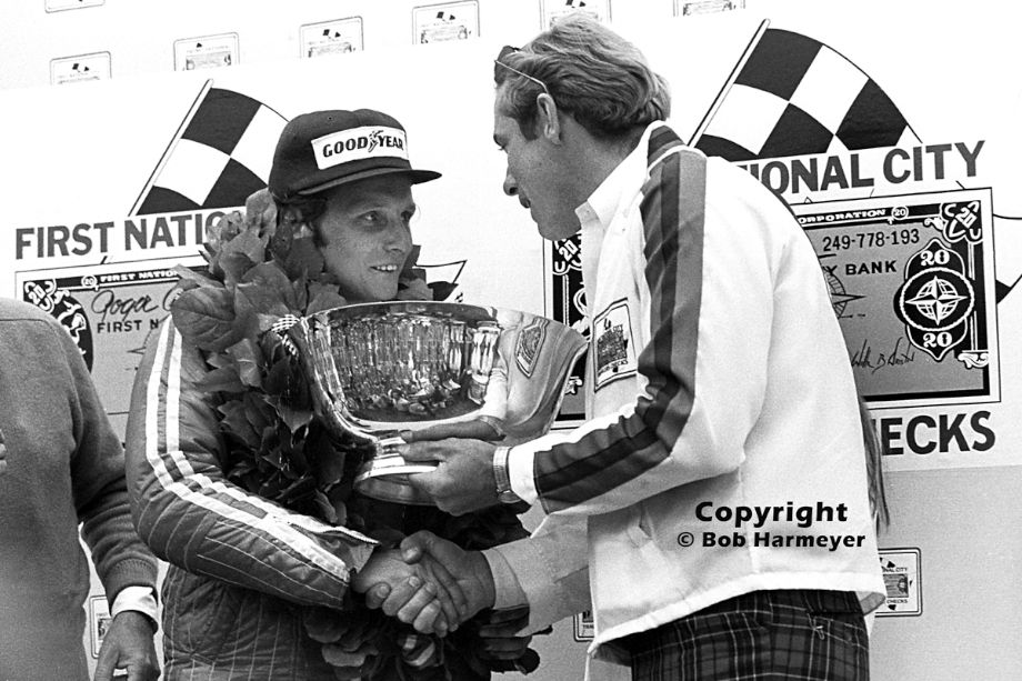 Niki Lauda receives the trophy for winning the 1975 United States Grand Prix at Watkins Glen. This was Lauda's fifth victory of the season for Ferrari, and his first World Championship.