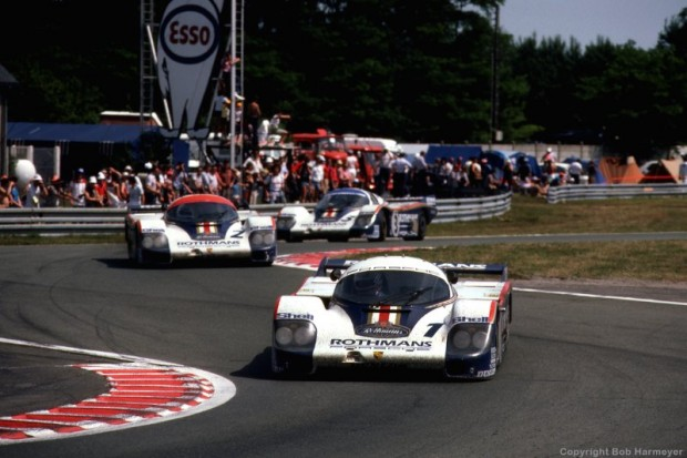 The winning Porsche 956 driven by Jacky Ickx and Derek Bell leads the other two Rothmans Porsche team cars near the finish of the 24 Hours of Le Mans in 1982.