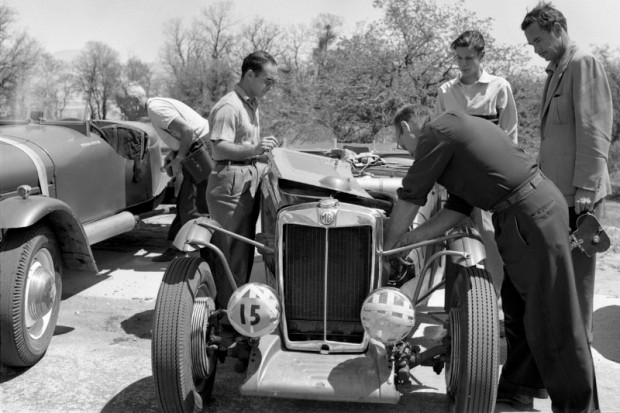 Ernie McAfee works on John Edgar's MG while others watch