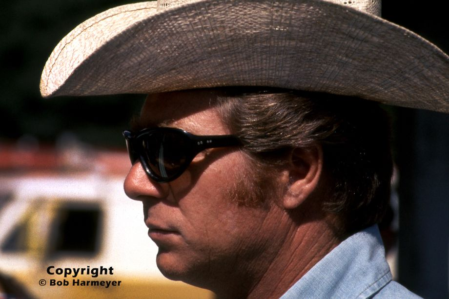 Jim Hall, photographed in the paddock area at Road America during the F5000 event in 1975. Although a top-flight designer in his own right, Hall teamed with Carl Haas to run a Lola/Chevrolet  in the F5000 series for Brian Redman, winning three consecutive championships.