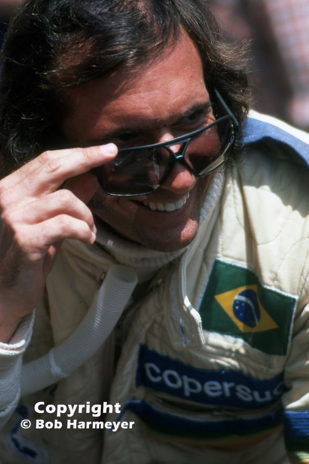 Emerson Fittipaldi, photographed during the production of a promotional film for Goodyear, in the pit lane before practice for the Monaco Grand Prix in 1976.
