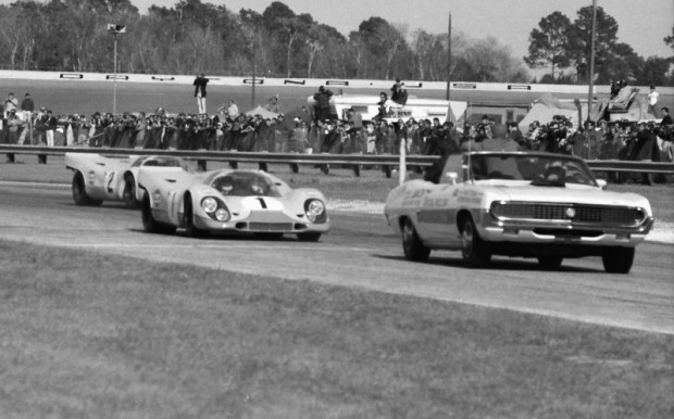 The pace lap for the 1970 24 Hours of Daytona.  Coming out of the old turn three and behind the camera car we see the #1 Porsche 917K of Jo Siffert and Brian Redman followed by the #2 Porsche 917K of Pedro Rodriguez and Leo Kinnunen.  The 'K' designation stood for Kurzheck or short back.