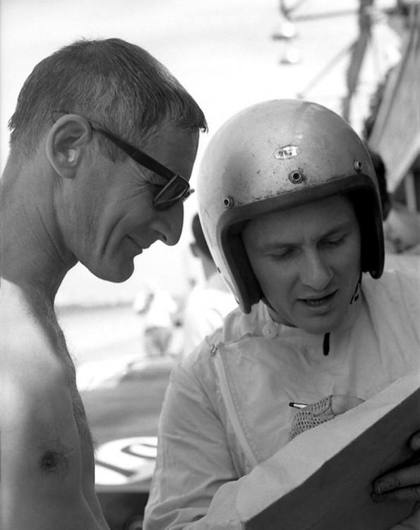 Ken Miles and Bruce McLaren study lap charts